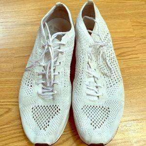 Nike running shoes in mesh.